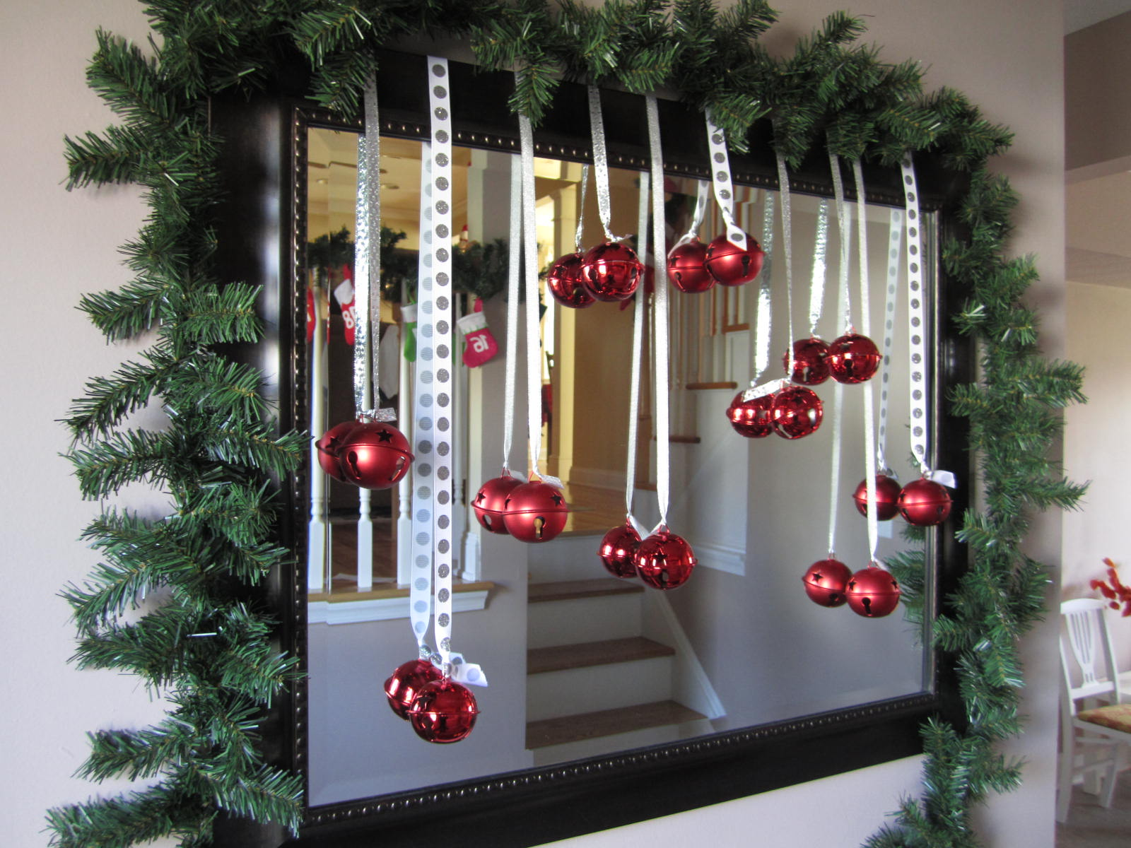 Christmas mirror emerald interiors blog for Hanging christmas decorations