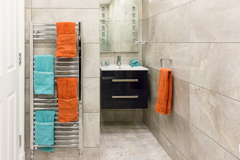Emerald Interior Design - tiled bathroom